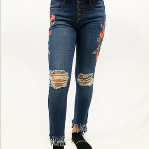 MACHINE embroidered distressed button fly jeans